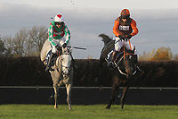 Rajdhani Express ridden by Mr S Waley-Cohen (R) and race wiiner Elenika ridden by Ruby Walsh in jumping action during the Tom Jones Memorial HTJ Centre Ltd Beginners Chase