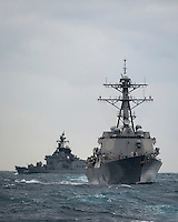 100110-N-7981E-642 PACIFIC OCEAN (Jan. 10, 2011)- The Japanese destroyer JS Kurama (DDH 144) joins formation with the Arleigh-Burke-class guided missile destroyers USS Gridley (DDG 101) and USS Stockdale (DDG 106) during a Passing Exercise (PASSEX).  Stockdale and Gridley are underway with the Carl Vinson Strike Group on a deployment to the U.S. 7th Fleet area of responsibility. (U.S. Navy photo by Mass Communication Specialist 2nd Class James R. Evans / RELEASED)