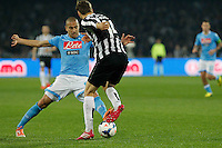 Gokhan Inler in action during the Italian Serie A soccer match between SSC Napoli and Juventus FC   at San Paolo stadium in Naples, March 30 , 2014
