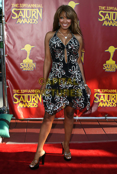 TRACI BINGHAM.33rd Annual Saturn Awards presented by the Academy Of Science Fiction, Fantasy and Horror Films held at the Universal City Hilton Hotel,Universal City, California, USA, 10 May 2007..full length black and silver beaded dress platform perspex shoes .CAP/ADM/CH.©Charles Harris/AdMedia/Capital Pictures.