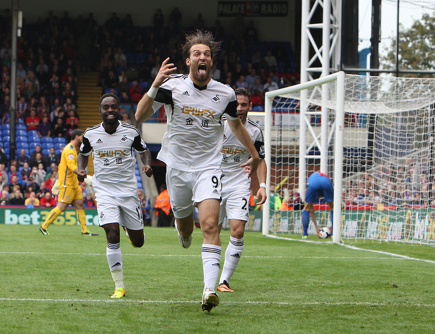 Swansea City's Michu celebrates scoring the opening goal <br /> <br /> Photo by Kieran Galvin/CameraSport<br /> <br /> Football - Barclays Premiership - Crystal Palace v Swansea City - Sunday 22nd September 2013 - Selhurst Park - London<br /> <br /> &copy; CameraSport - 43 Linden Ave. Countesthorpe. Leicester. England. LE8 5PG - Tel: +44 (0) 116 277 4147 - admin@camerasport.com - www.camerasport.com