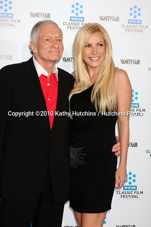 ".Hugh Heifner & Geust.arrives at the ""A Star is Born"" Restored Print World Premiere , part of the Turner Classic Movie Channel Classic Movie Festival.Grauman'S Chinese.Los Angeles, CA.April 22, 2010.©2010 Kathy Hutchins / Hutchins Photo..."