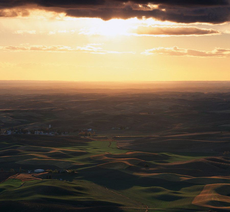 The hot sun overpowers the clouds as it sets over the Palouse during the summer.
