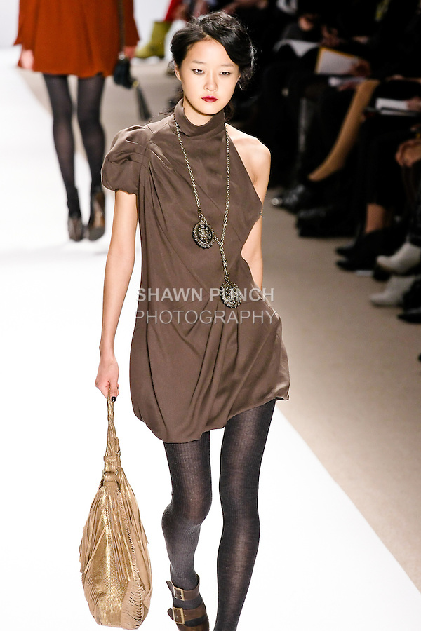 Hyoni Kang walks the runway in an olive dress, and gold bag, by Nanette Lepore, for her Nanette Lepore Fall 2010 collection fashion show, during Mercedes-Benz Fashion Week Fall 2010.