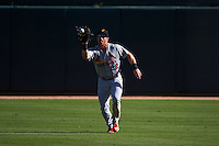 Surprise Saguaros outfielder Charlie Tilson (22) catches a fly ball during an Arizona Fall League game against the Glendale Desert Dogs on October 24, 2015 at Camelback Ranch in Glendale, Arizona.  Surprise defeated Glendale 18-3.  (Mike Janes/Four Seam Images)
