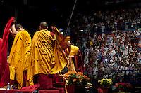 Milano: fedeli di religione buddista durante la preghiera alla presenza del Dalai Lama Tenzin Gyatso..Milan: followers of Buddhist religion during the prayer meeting with  the Dalai Lama Tenzin Gyatso