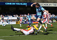 Jack Barthram of Cheltenham Town collides with his goalkeeper Rob Lainton of Cheltenham Town (on loan from Bury) blocking a Dayle Southwell of Wycombe Wanderers shot and is injured during the Sky Bet League 2 match between Wycombe Wanderers and Cheltenham Town at Adams Park, High Wycombe, England on the 8th April 2017. Photo by Liam McAvoy.