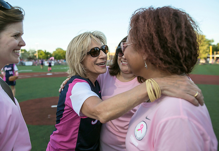 UNITED STATES - JUNE 24 - NBC News commentator Andrea Mitchell, hugs fellow Breast Cancer survivors during the seventh annual Congressional women's softball game near Capitol Hill in Washington D.C. on Wednesday, June 24, 2015. (Photo By Al Drago/CQ Roll Call)