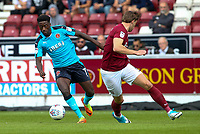 Fleetwood Town's Jordy Hiwula competing with Northampton Town's Ash Taylor .<br /> <br /> Photographer Andrew Kearns/CameraSport<br /> <br /> The EFL Sky Bet League One - Northampton Town v Fleetwood Town - Saturday August 12th 2017 - Sixfields Stadium - Northampton<br /> <br /> World Copyright &copy; 2017 CameraSport. All rights reserved. 43 Linden Ave. Countesthorpe. Leicester. England. LE8 5PG - Tel: +44 (0) 116 277 4147 - admin@camerasport.com - www.camerasport.com
