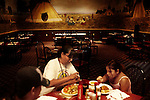 ".Fort Thompson, SD, USA. July 2009.A family eats in the restaurant in the ""Lode Star Casino"" in Crow Creek.  ""When the bills are payed the casino barely keeps itself running,"" the Tribal Chairman Brandon Sazue explains."