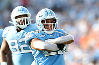 CHAPEL HILL, NC - SEPTEMBER 28: Chazz Surratt #21 of the University of North Carolina poses after making a sack during a game between Clemson University and University of North Carolina at Kenan Memorial Stadium on September 28, 2019 in Chapel Hill, North Carolina.