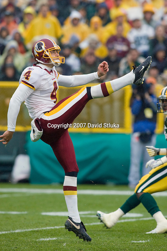 Punter Derrick Frost #4 of the Washington Redskins punts the ball during an NFL football game against the Green Bay Packers at Lambeau Field on October 14, 2007 in Green Bay, Wisconsin. The Packers beat the Redskins 17-14. (Photo by David Stluka)