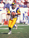 St. Louis Rams, Kurt Warner (13) during a game against the Tennessee Titans on October 31, 1999 at Adelphia Coliseum in Nashville, Tennessee.  The Titans beat the Rams 24-21. Kurt Warner played for 12 years with 3 different teams and was a 4-time Pro Bowler.