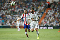 Sergio Ramos of Real Madrid and Koke of Atletico de Madrid during La Liga match between Real Madrid and Atletico de Madrid at Santiago Bernabeu stadium in Madrid, Spain. September 13, 2014. (ALTERPHOTOS/Caro Marin)
