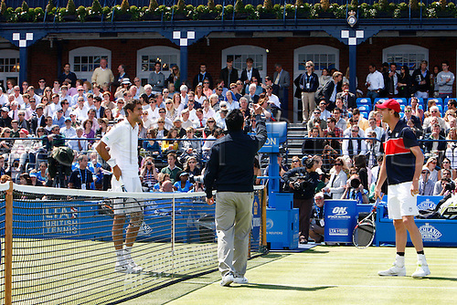 16.06.12 Queens Club, London, ENGLAND: ..Umpire Jame Keothavong tosses the coin..mens singles semi-final round match during Marin Cilic CRO  versus Sam Querrey USA on day Six of the Aegon Championships at Queens Club ..on June 16, 2012 in London , England.........