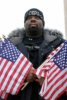 Lloyd Hardy, 33 of Washington DC in the crowd which filled The Mall during the Opening Inaugural Celebration two days before the inauguration of Barack Obama as the 44th President of the United States.