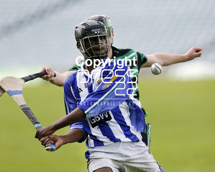 XX SPORT 07/07/2013 Sean French of Douglas tracks a run from Christin Tshibangu of Ballyboden St Enda's  in the Feile Na nGael Division 1 final at the Gaelic Grounds, Limerick. Picture: Don Moloney / Press 22