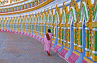 Doorways at a Monestary in northern Burma, a women priest walking along the colorful design