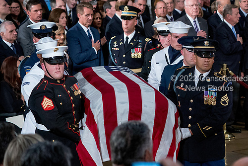 Sen. Jeff Flake, R-Ariz., top center left, watches as the casket of Sen. John McCain, R-Ariz., is brought into the Rotunda of the U.S. Capitol, Friday, Aug. 31, 2018, in Washington. (AP Photo/Andrew Harnik, Pool)