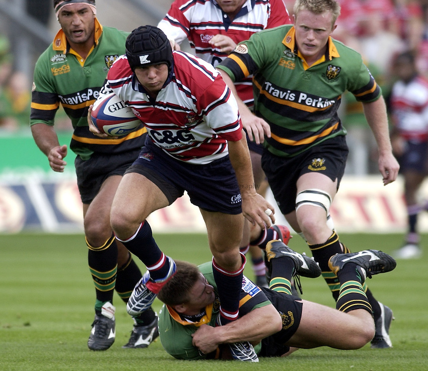 Photo. Henry Browne..06/09/2003..Northampton Saints v Gloucester pre season friendly..Henry Paul attacks.
