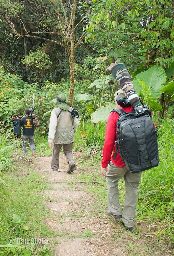 Photographers on a rainforest trail at San Jorge de Milpe Eco-Lodge, Ecuador