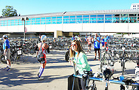 Volunteers help athletes find their bikes to begin the second leg of the 2015 Ironman competition on Sunday, September 13, 2015 in Madison, Wisconsin