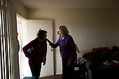 Los Angeles, California<br /> January 28, 2014<br /> <br /> Former homeless veteran Michael Brody 72 yrs old in his apartment that he has because of a HUD Vash voucher. A VA nurse chats with him during a recent visit.