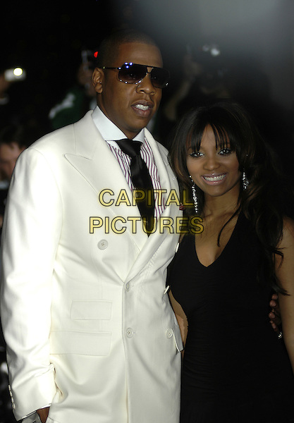 JAY-Z & TEAIRRA MARI.Arriving at The GQ men of The Year Awards,.The Royal Opera House,.London, 6th September 2005,.half length white suit black dress sunglasses.www.capitalpictures.com.sales@capitalpictures.com.©Capital Pictures
