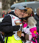 Mushers DeeDee Jonrowe and Jeff King at the ceremenial start of the 43rd Annual Iditarod in Anchorage, Alaska. The 1000 mile dog sled race usually restarts in Willow, Alaska, and finishes in Nome. Poor snowfall, however, forced the restart north to Fairbanks.