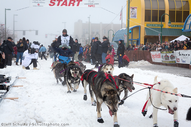 John Baker and team leave the ceremonial start line at 4th Avenue and D street in downtown Anchorage during the 2013 Iditarod race. Photo by Jim R. Kohl/IditarodPhotos.com