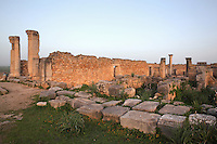 The House of the Columns, with columns of different styles around its central courtyard, including a spiral column with Corinthian capital (on the right), Volubilis, Northern Morocco. Volubilis was founded in the 3rd century BC by the Phoenicians and was a Roman settlement from the 1st century AD. Volubilis was a thriving Roman olive growing town until 280 AD and was settled until the 11th century. The buildings were largely destroyed by an earthquake in the 18th century and have since been excavated and partly restored. Volubilis was listed as a UNESCO World Heritage Site in 1997. Picture by Manuel Cohen