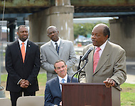 August 25, 2011 (Washington, DC)  On August 25, 2011, DC Mayor Vincent Gray (D-DC) (seated) held a press conference announcing the designation of the Southeast/Southwest Freeway, the 11th Street Bridge and sections of Maine and Independence Avenues SW as Martin Luther King, Jr. Drive.  Also attending were Terry Bellamy (standing center) Director, DC Department of Transportation (DDOT), Councilmembers Marion Barry Jr. (D-Ward 8) (standing right) and Vincent Orange (D-At Large), and Harry E. Johnson Sr., president & CEO of the Martin Luther King, Jr. National Memorial Project Foundation, Inc. (not pictued)  (Photo by Don Baxter/Media Images International)
