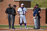 High Point Panthers head coach Craig Cozart (36) goes over the ground rules with NJIT Highlanders head coach Brian Guiliana and umpires Tommy Caudle, Randal Dulin, and Kevin Morgan at Williard Stadium on February 18, 2017 in High Point, North Carolina. The Panthers defeated the Highlanders 11-0 in game one of a double-header. (Brian Westerholt/Four Seam Images)