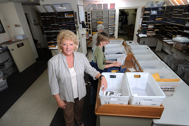 Carol Denney in the mail distribution center for the Business Operations Annual Report