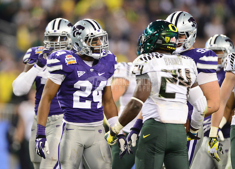 Jan. 3, 2013; Glendale, AZ, USA: Oregon Ducks running back Kenjon Barner (right) argues with Kansas State Wildcats defensive back Nigel Malone during the 2013 Fiesta Bowl at University of Phoenix Stadium. Oregon defeated Kansas State 35-17. Mandatory Credit: Mark J. Rebilas-