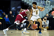 Washington, DC - MAR 7, 2018: La Salle Explorers guard Pookie Powell (0) plays defense against Massachusetts Minutemen guard Carl Pierre (12) during game between La Salle and UMass during first round action of the Atlantic 10 Basketball Tournament at the Capital One Arena in Washington, DC. (Photo by Phil Peters/Media Images International)