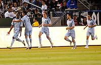Sporting KC forward C.J. Sapong (17) celebrates his goal with teammates. Sporting KC defeated CD Chivas USA 3-2 at Home Depot Center stadium in Carson, California on Saturday March 19, 2011...