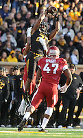 NWA Media/Michael Woods --11/28/2014-- w @NWAMICHAELW...Missouri receiver Bud Sasser goes up to make a catch between University of Arkansas defenders Jared Collins (29) and Martrell Spaight the 3rd quarter of Friday afternoons game against Missouri at Faurot Field in Columbia Missouri.