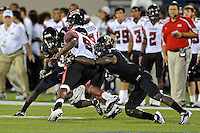 24 September 2011:  FIU safety Jonathan Cyprien (7) tackles ULL wide receiver Darryl Surgent (87) in the third quarter as the University of Louisiana-Lafayette Ragin Cajuns defeated the FIU Golden Panthers, 36-31, at FIU Stadium in Miami, Florida.