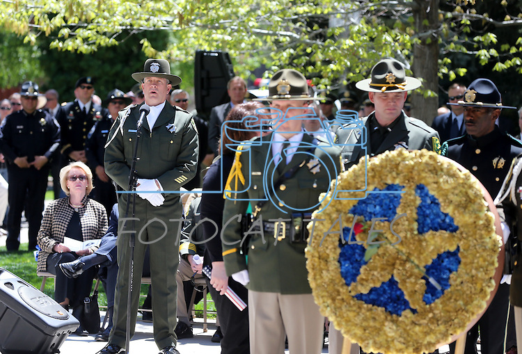 Storey County Sheriff's Deputy Shawn Mahan sings at the Nevada Law Enforcement Officers Memorial Ceremony on Thursday, May 2, 2013, at the Capitol in Carson City, Nev..Photo by Cathleen Allison