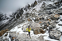 Trail running down Renjo La Pass while on a running tour of the 3 Passes Tour, Khumbu Valley, Nepal.