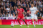 David Alaba (L) of FC Bayern Munich is followed by Marco Asensio Willemsen of Real Madrid during the UEFA Champions League Semi-final 2nd leg match between Real Madrid and Bayern Munich at the Estadio Santiago Bernabeu on May 01 2018 in Madrid, Spain. Photo by Diego Souto / Power Sport Images
