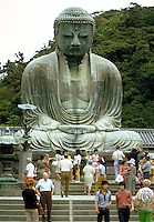 Great image of Buddha Daibutsu, Kamakura, Japan with visitors goin up the steps directly in front of it. This colossal Buddha is found in the monastery of Todai-ji, built in 745 AD. Kamakura, Japan Todai-Ji Monastery.