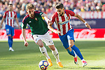 Fausto Tienza of Club Atletico Osasuna competes for the ball with Yannick Ferreira Carrasco of Atletico de Madrid during the match of La Liga between  Atletico de Madrid and Club Atletico Osasuna at Vicente Calderon  Stadium  in Madrid, Spain. April 15, 2017. (ALTERPHOTOS / Rodrigo Jimenez)
