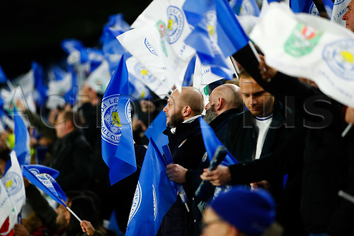 8th January 2020; King Power Stadium, Leicester, Midlands, England; English Football League Cup Football, Carabao Cup, Leicester City versus Aston Villa; Leicester City supporters pictured with free souvenir flags before kick off - Strictly Editorial Use Only. No use with unauthorized audio, video, data, fixture lists, club/league logos or 'live' services. Online in-match use limited to 120 images, no video emulation. No use in betting, games or single club/league/player publications