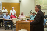 NWA Democrat-Gazette/ANTHONY REYES • @NWATONYR<br /> Mike Peters gives a few remarks before he is sworn in as Springdale Police Chief Friday, Sept. 11, 2015 at the Springdale City Hall. Peters has been the acting police chief since the Chief Kathy O'Kelly earlier in the year.
