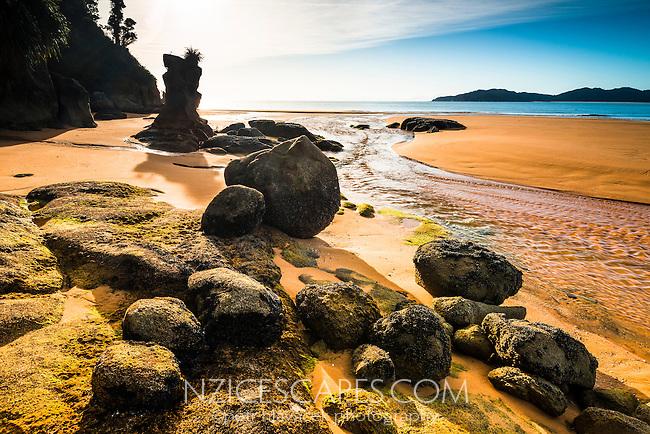 Rock formations on pristine and empty beach in Totaranui on Abel Tasman Coastal Track, Abel Tasman National Park, Nelson Region, South Island, New Zealand