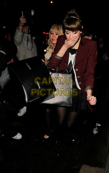 PEACHES GELDOF.Nokia & PPQ Launch Party at PPQ Boutique, Conduit Street, London, England, January 29th 2008..full length red maroon coat hand over face mouth funny black shoes tights fringe bags .CAP/CAN.©Can Nguyen/Capital Pictures