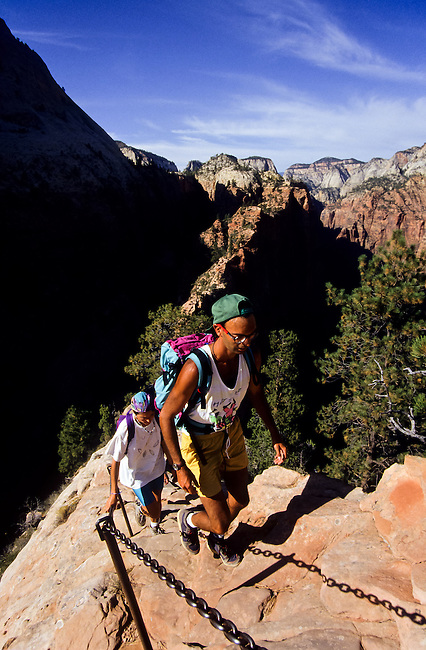 Hikers balancing on Angels landing in  Zion National Park, Utah, USA