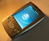A Dell Axim personal digital assistant (PDA) dating back to circa 2003 is seen in New York on Wednesday, February 6, 2013. Michael Dell with investors plans on buying back the company and taking it private in a $24 billion deal. (© Richard B. Levine)
